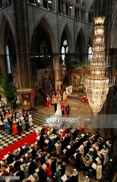 Prince William and Catherine Middleton with Michael Middleton and Prince Harry stand at the altar during the Royal Wedding of Prince William to...
