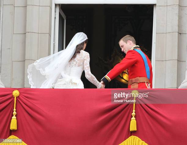 Prince William and his bride Catherine Middleton stand on the balcony of Buckingham Palace following their Royal Wedding at Westminster Abbey on...