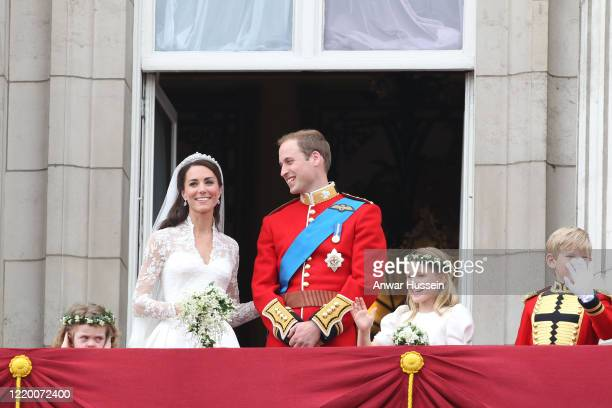 Prince William and his bride Catherine Middleton with bridesmaids Grace Van Cutsem and Margarita Armstrong-Jones, stand on the balcony of Buckingham...