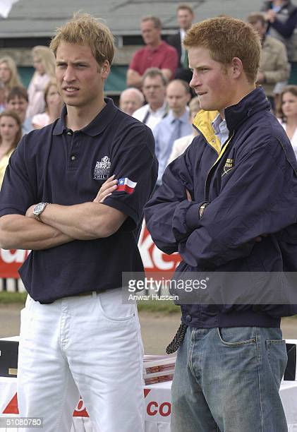 Prince William and his brother Prince Harry at Cirencester Park Polo Club for the Queen Mother's Cup on July 18 2004 in Cirencester England