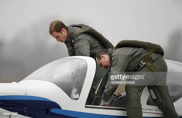 Prince William and his instructor Squadron Leader Roger Bousfield board a Grob 115E light aircraft known as the Tutor while training at airbase RAF...