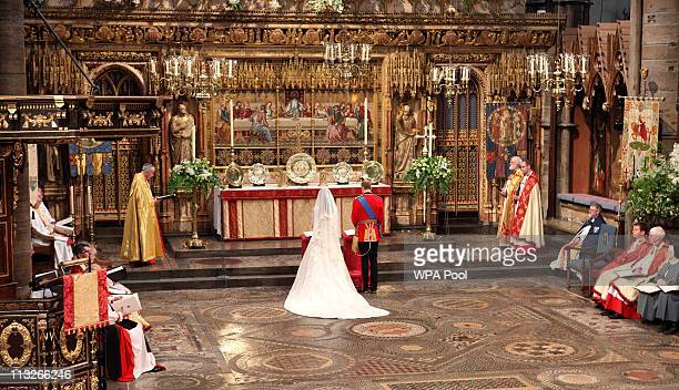 Prince William and his new bride Catherine Middleton stand in front of the altar during the service on April 29 2011 in London England The marriage...