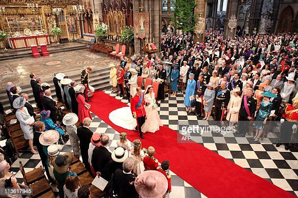 Prince William and his wife Kate Duchess of Cambridge walk down the aisle of Westminster Abbey after their royal wedding in central London on April...