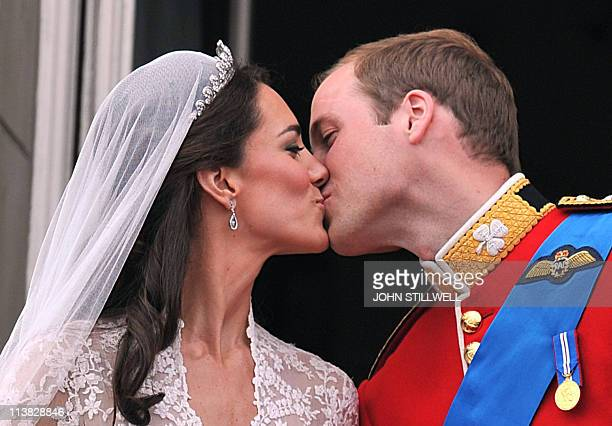 Prince William and his wife Kate Middleton Duchess of Cambridge kiss on the balcony of Buckingham Palace in London following their wedding on April...