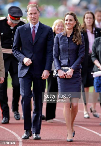 Prince William and Kate Middleton walk round an athletics track during a visit to Witton Country Park on April 11 2011 in Darwen England