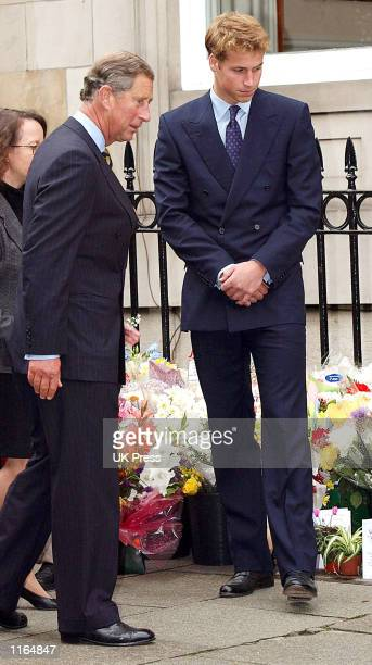 Prince William and Prince Charles stand in front of the American Consulate in Edinburgh September 21 2001 after signing the condolence book for the...