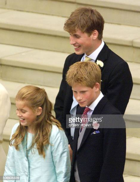 Prince William and Prince Harry and an unidentified member of the royal family smile as they watch Prince Edward and Sophie RhysJones leave St...