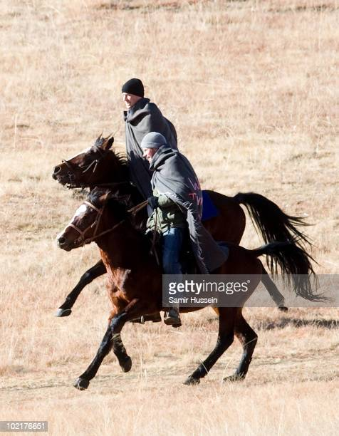 Prince William and Prince Harry arrive on horseback at the Semongkong Children's Centre on June 17 2010 in Semongkong Lesotho The Princes are on a...