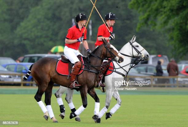 Prince William and Prince Harry attend a charity polo match at Cirencester Park Polo Club on June 7 2009 in Cirencester England
