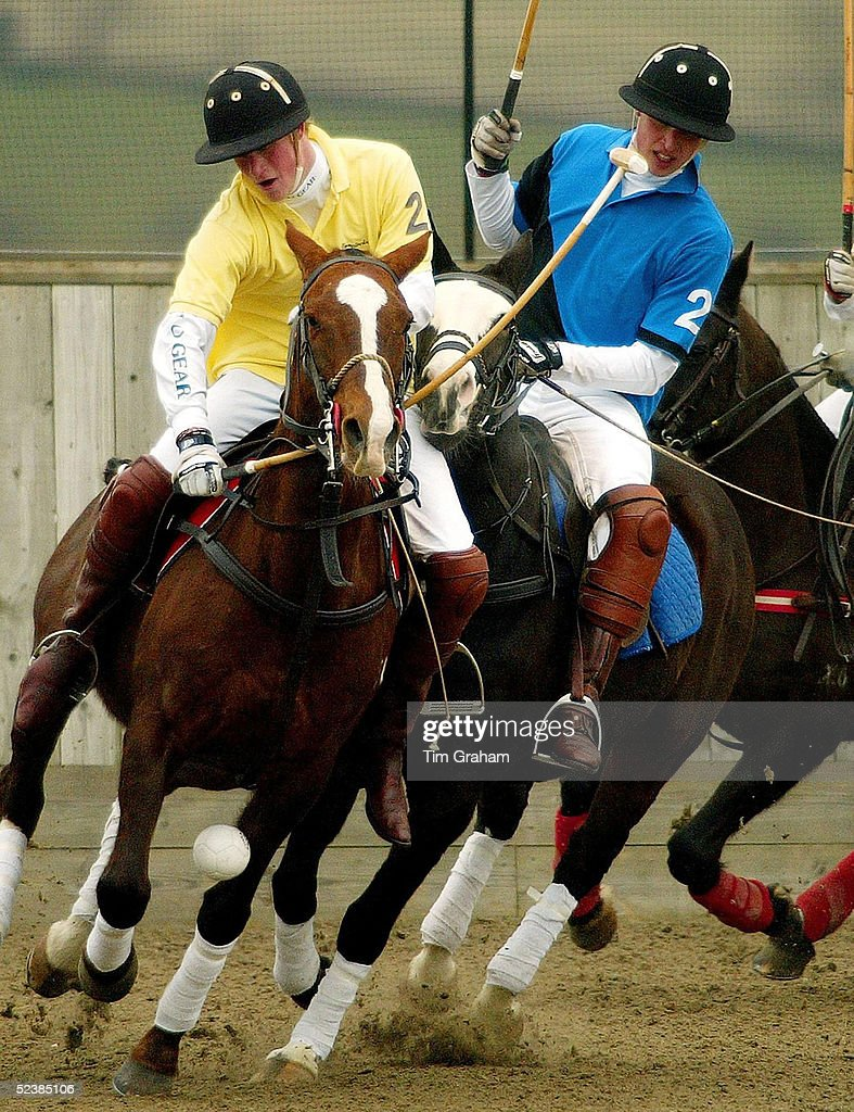Prince William and Prince Harry barging each other while taking part in a polo match playing for the Hayley Charity Trophy in aid of victims of Indian Earthquake Tsunami held at Longdole Polo Club on March 12, 2005 in Birdlip, England. Prince Harry was on the winning team.