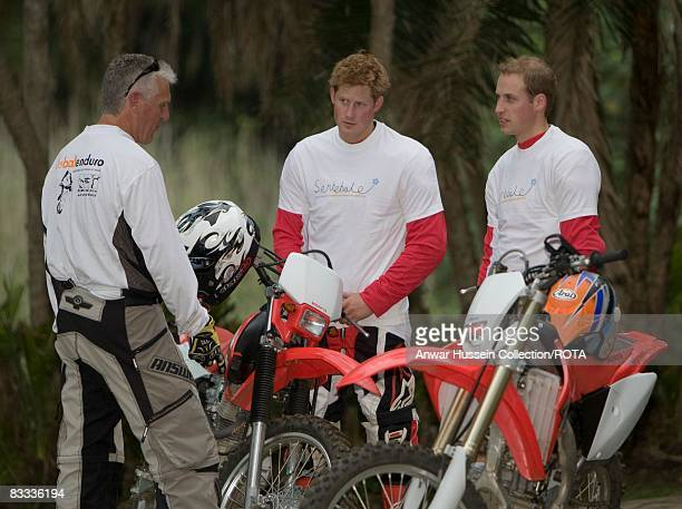 Prince William and Prince Harry chat to team leader Mike Glover at a practice session for the Enduro 2008 Motorcycle Rally to benefit UNICEF the...