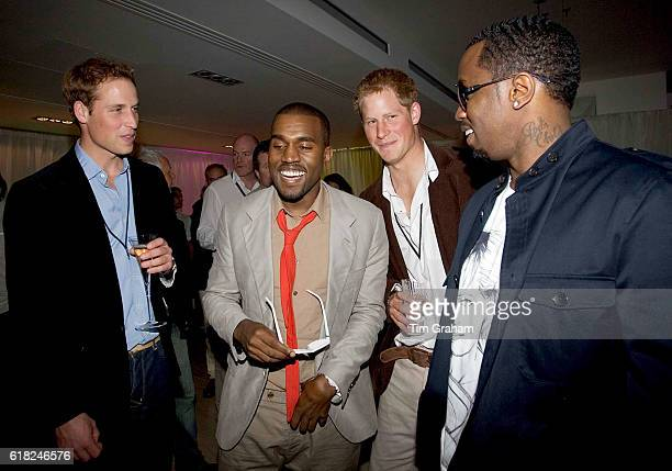 Prince William and Prince Harry meet P Diddy and Kanye West at the afterconcert party the Princes hosted to thank all who took part in the Concert...