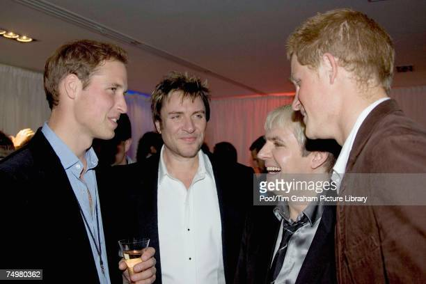 Prince William and Prince Harry meet Simon Le Bon and Nick Rhodes of Duran Duran at the after concert party the Princes hosted to thank all who took...