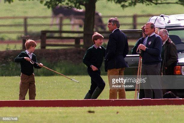 Prince William and Prince Harry play around together at Cirencester Park polo club in May 1995 in Cirencester England