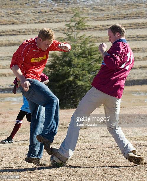 Prince William and Prince Harry play football with children during a visit to the Semongkong Children's Centre on June 17 2010 in Semongkong Lesotho...