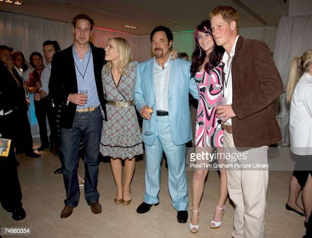 Prince William and Prince Harry pose for a photograph with Natasha Bedingfield Joss Stone and Tom Jones at the after concert party the Princes hosted...