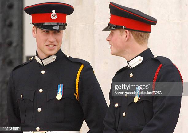Prince William and Prince Harry smile at the passing-out Sovereign's Parade at Sandhurst Military Academy on April 12, 2006 in Sandhurst, England.