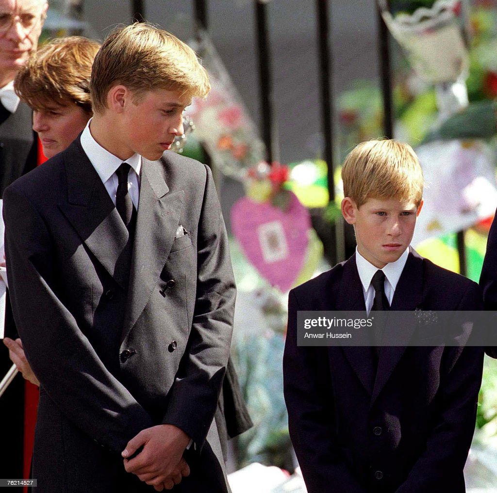 Prince William and Prince Harry stand outside Westminster Abbey at the funeral of Diana, Princess of Wales on September 6, 1997 in London, England.