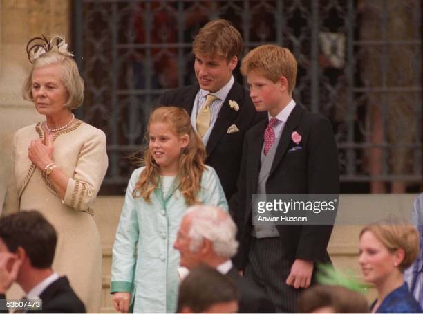 Prince William and Prince Harry stand with Princess Beatrice and the Duchess of Kent as they leave St George's Chapel Windsor following the wedding...