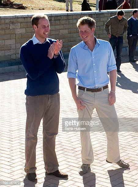 Prince William and Prince Harry watch children dancing at the Mamohato Network Club for children affected by HIV at King Letsie's Palace on June 17,...