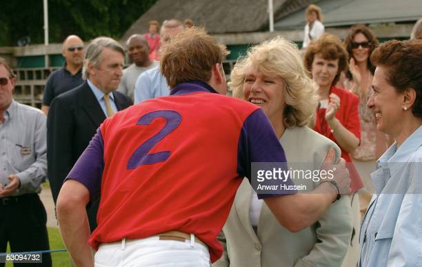 Prince William and The Duchess of Cornwall kiss during the Burberry Cup at Cirencester Park Polo Club on June 17 2005 in Gloucestershire England Rose...