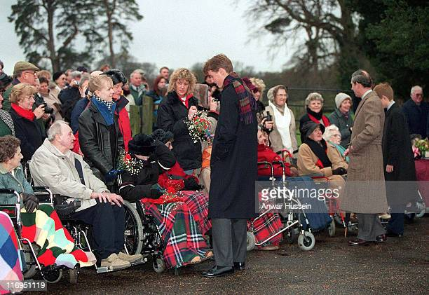 Prince William and the Prince of Wales meet the public after the Christmas Day church service at Sandringham in 1998