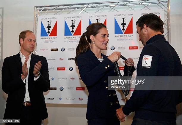 Prince William applauds as Catherine Duchess of Cambridge presents a medal to Sir Ben Ainslie skipper of Britain's Land Roverbacked BAR team at the...