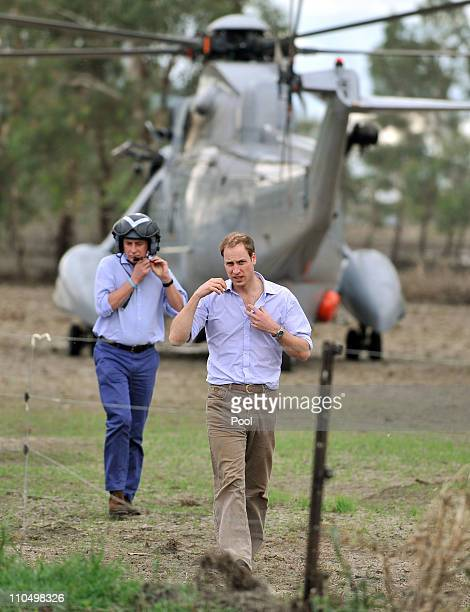 Prince William arrives by helicopter for a tour of Brad and Leonie Wren's dairy property on March 21 2011 in Benjeroop Australia Prince William is on...