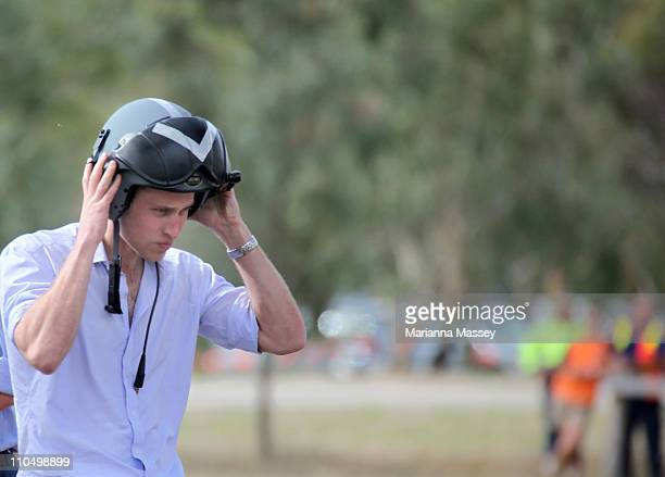 Prince William arrives by helicopter in Marrabit to attend a community BBQ at the local recreational grounds on March 21 2011 in Kerang Australia His...