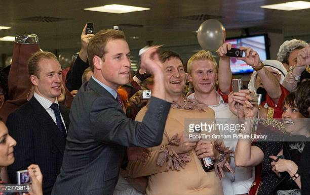 Prince William as Patron of the Tusk Trust, throws a dart during the City inter-dealer broker firm ICAP's Charity Day fancy dress party on December...