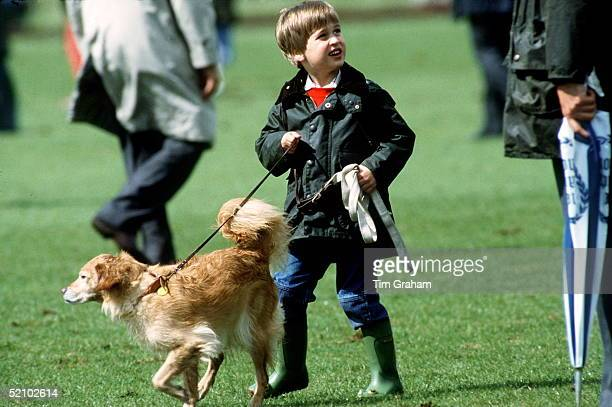 Prince William At Polo Cirencester Walking A Pet Dog