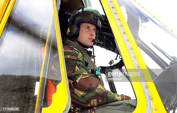 Prince William at the controls of a Sea King helicopter during a training exercise at Holyhead Mountain having flown from RAF Valley on March 31 2011...