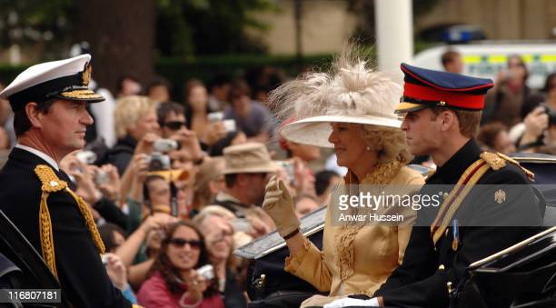 Prince William, Camilla, Duchess of Cornwall and Timothy Laurence sit in an open carriage at the Trooping the Colour Ceremony in London on June 16,...