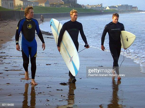 Prince William Carrying A Surfboard As He Walks With Two Friends Along The Shoreline At St Andrews In Scotland Where He Is In The Last Year Of His...