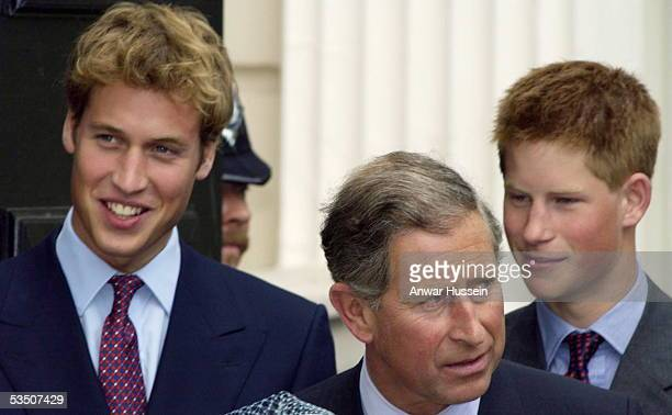 Prince William Charles Prince of Wales and Prince Harry stand outside Clarence House on the Queen Mother's 101st birthday on August 4 2001 in London...