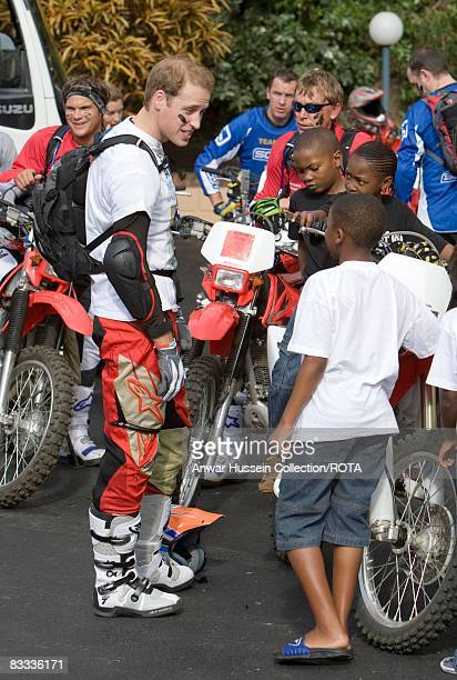Prince William chats to local children as he prepares to set off at the start of the Enduro 2008 Motorcycle Rally to benefit UNICEF the Nelson...