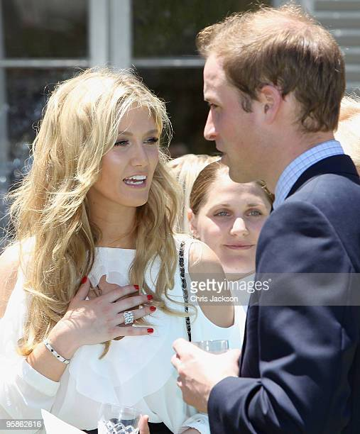 Prince William chats to pop singer Delta Goodrem while lunching at Admiralty House on January 19 2010 in Sydney Australia HRH flew to Sydney today...