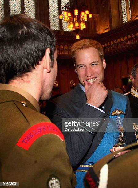 Prince William chats with soldiers during a reception at London Guildhall after a Service of Commemoration to mark the end of combat operations in...
