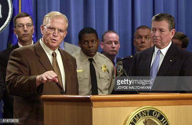 Prince William County Prosecutor Paul Ebbert answers reporters questions as US Attorney General John Ashcroft looks on during a press conference 07...