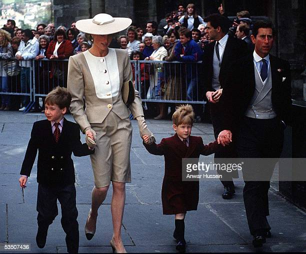 Prince William Diana Princess of Wales Prince Harry and Charles Prince of Wales attend the wedding of the Duke of Hussey's daughter in May 1989 in...
