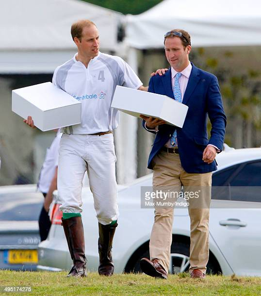 Prince William Duke of Cambridge accompanied by Andrew Tucker seen after playing in the Audi Polo Challenge at Coworth Park Polo Club on June 1 2014...