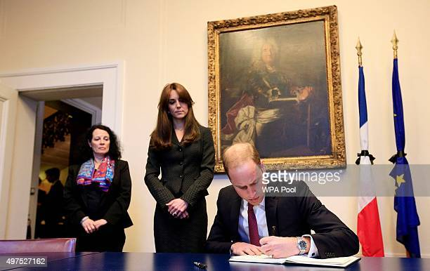 Prince William, Duke of Cambridge, accompanied by Catherine, Duchess of Cambridge, signs the book of condolences after the terror attacks which...