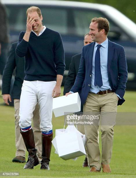 Prince William Duke of Cambridge accompanied by his Polo Manager Andrew Tucker attends day 2 of the Audi Polo Challenge at Coworth Park on May 31...