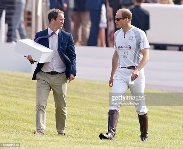 Prince William Duke of Cambridge accompanied by his polo manager Andrew Tucker attends the Audi Polo Challenge at Coworth Park Polo Club on May 29...