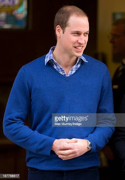Prince William Duke of Cambridge accompanies his pregnant wife Catherine Duchess of Cambridge as they leave the King Edward VII hospital where The...