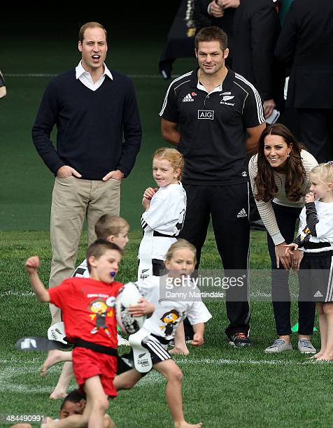 Prince William Duke of Cambridge All Blacks player Richie McCaw and Catherine Duchess of Cambridge watch a Rippa Rugby tournament at Forsyth Barr...