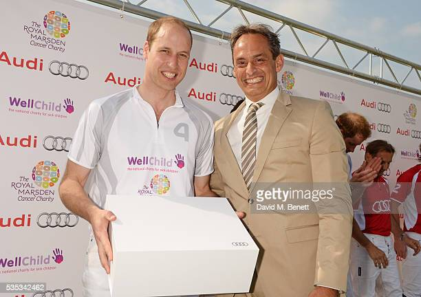 Prince William Duke of Cambridge and Andre Konsbruck Director of Audi UK attend day two of the Audi Polo Challenge at Coworth Park on May 29 2016 in...