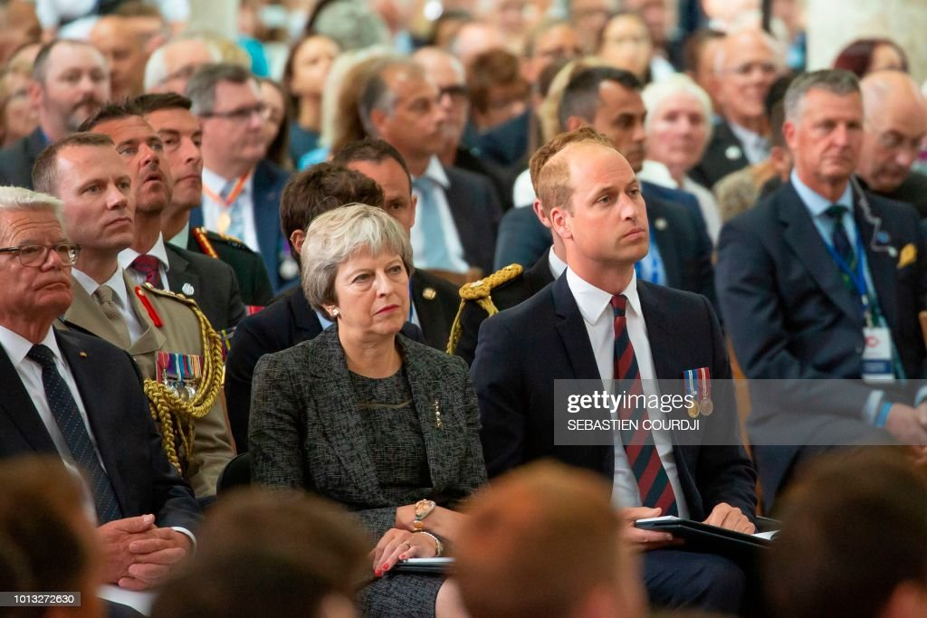 Prince William Duke of Cambridge and Britain's Prime minister Theresa May attend a religious ceremony to mark the 100th anniversary of the World War I (WW1) Battle of Amiens, at the Cathedral in Amiens, France, August 8, 2018. - The Battle of Amiens sounded the start of the Hundred Days Offensive on the Western Front, which led to the Armistice in November 1918.