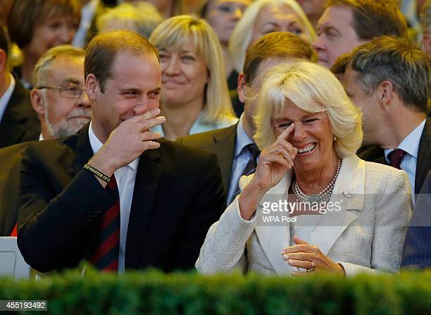 Prince William, Duke of Cambridge and Camilla, Duchess of Cornwall, laugh during the opening ceremony of the Invictus Games at the Queen Elizabeth...
