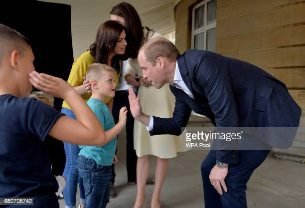 Prince William Duke of Cambridge and Catherine and Duchess of Cambridge backstage with Samantha Davidson and her children Jayden and Jamie as they...
